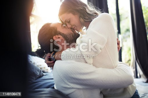 Romantic couple at home share tenderness