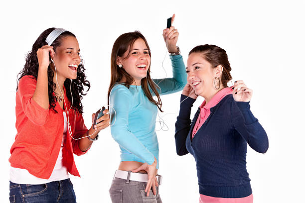 Sharing music on a mp3 device and dancing stock photo