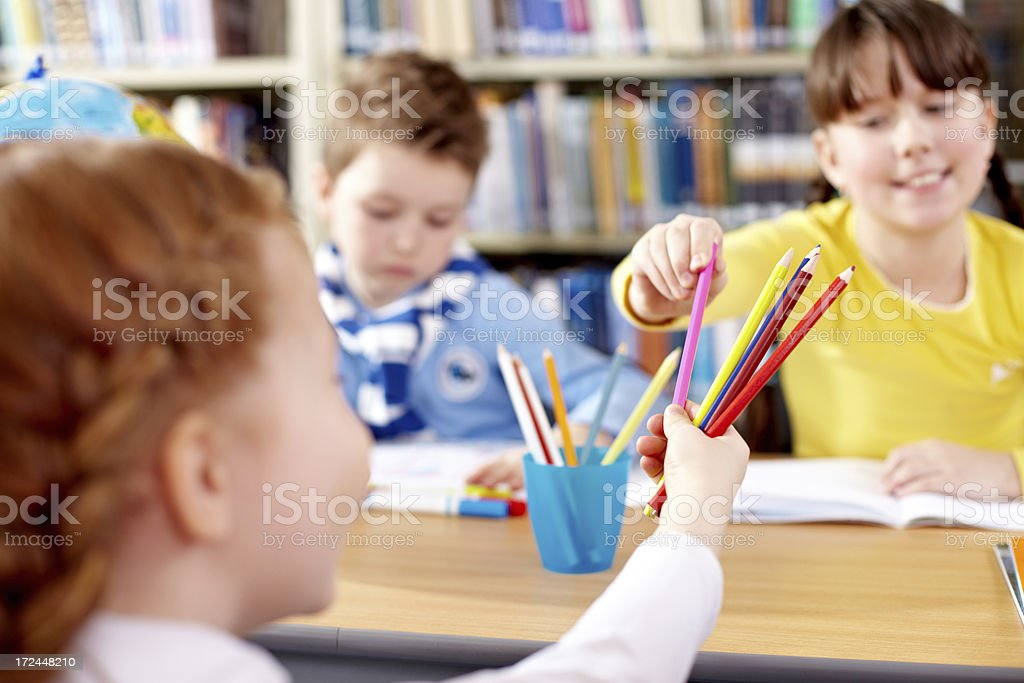 Sharing pencils royalty-free stock photo
