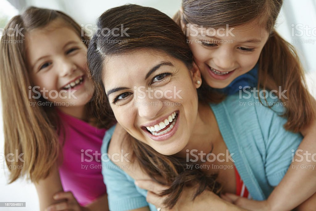 Sharing playful laughs with her daughter stock photo