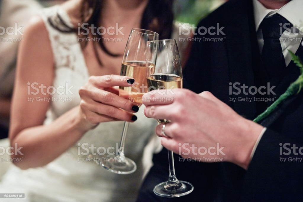 Sharing the first toast as Mr and Mrs stock photo