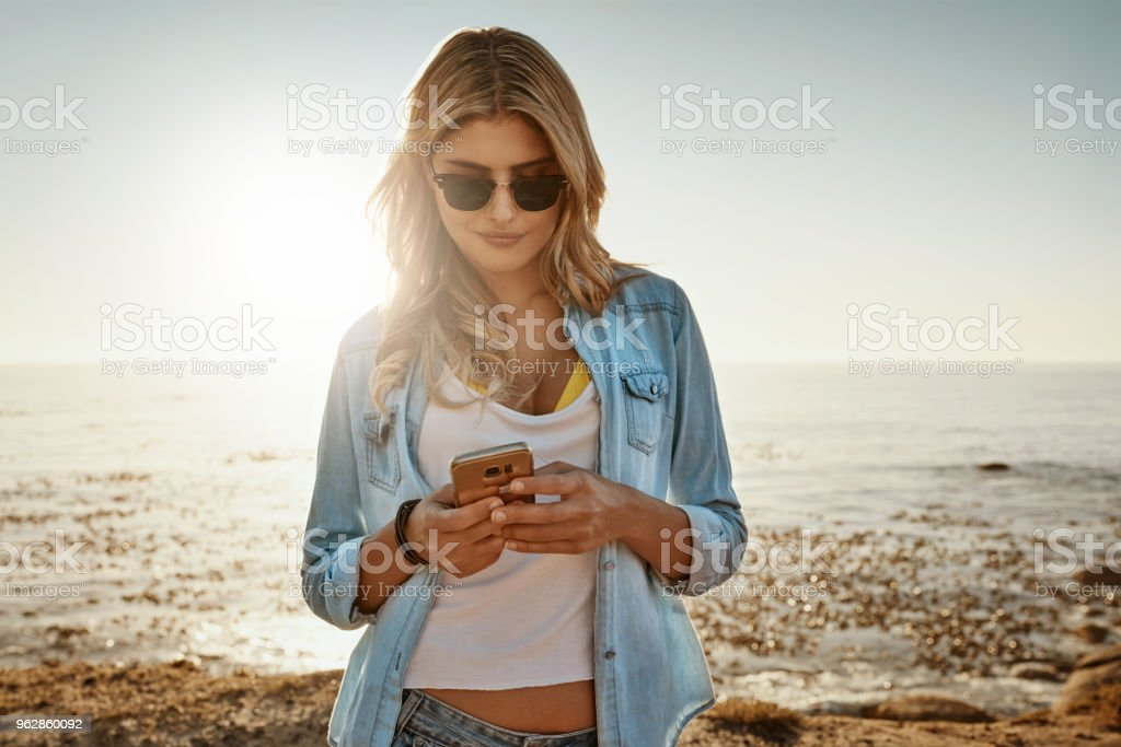 Sharing the summer day on social media stock photo