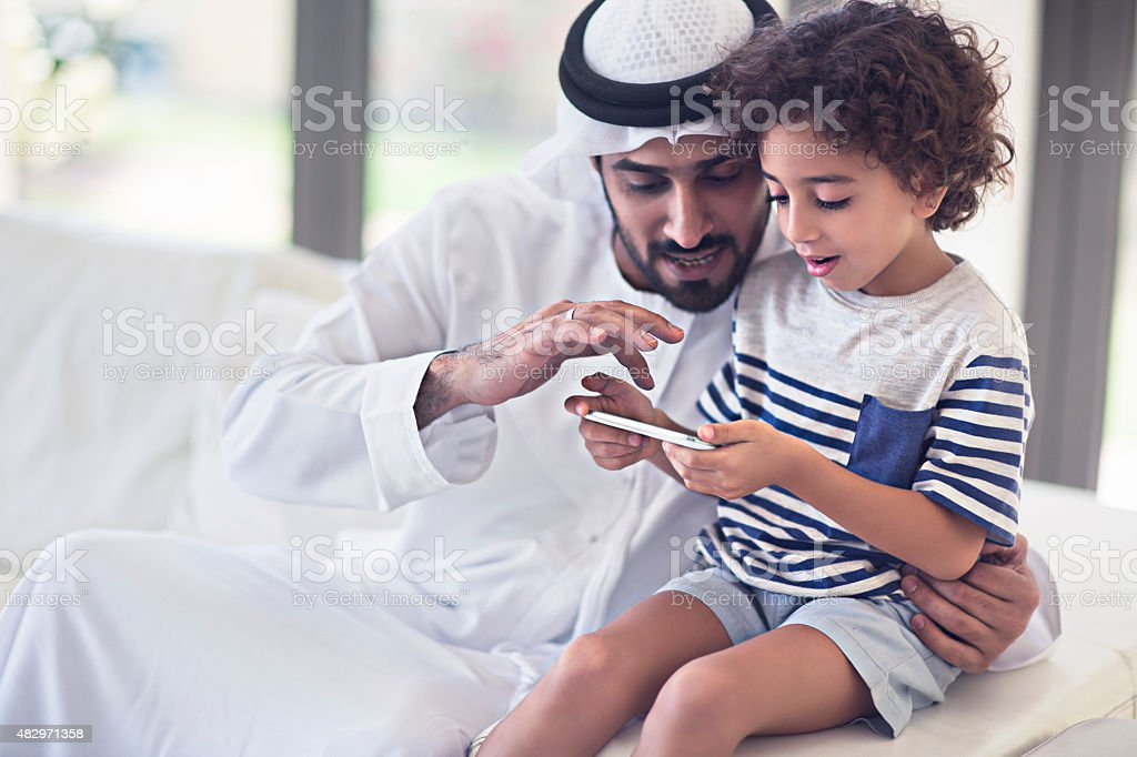 Sharings time with his son stock photo