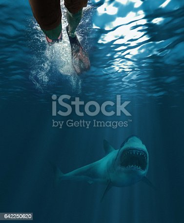 Underwater shot of a swimmer and a great white shark approaching with his mouth open