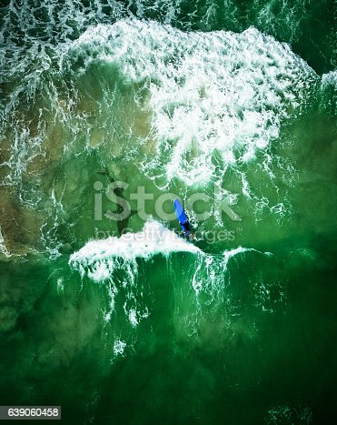 shark on the sea close to a surfer