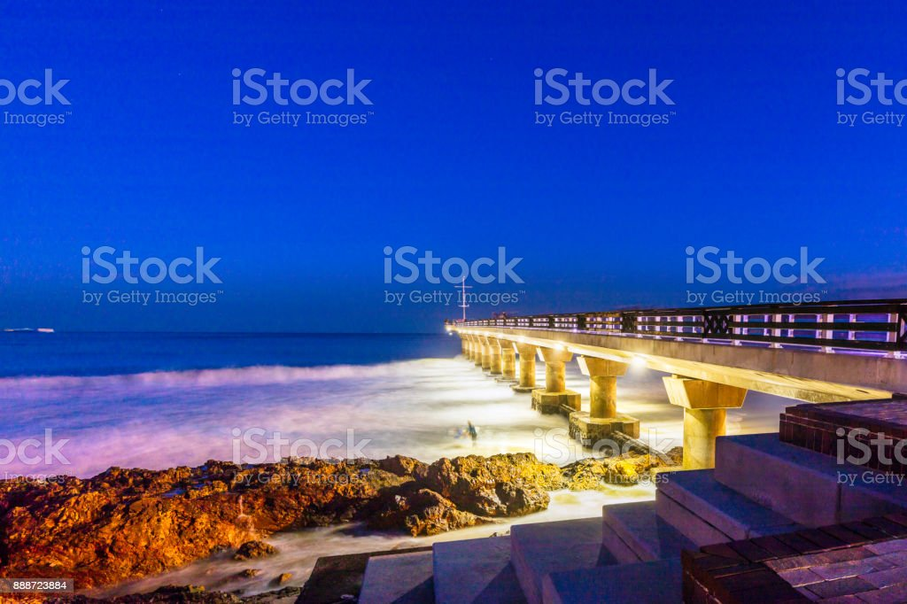 Shark Rock Pier at night in Port Elizabeth, South Africa stock photo