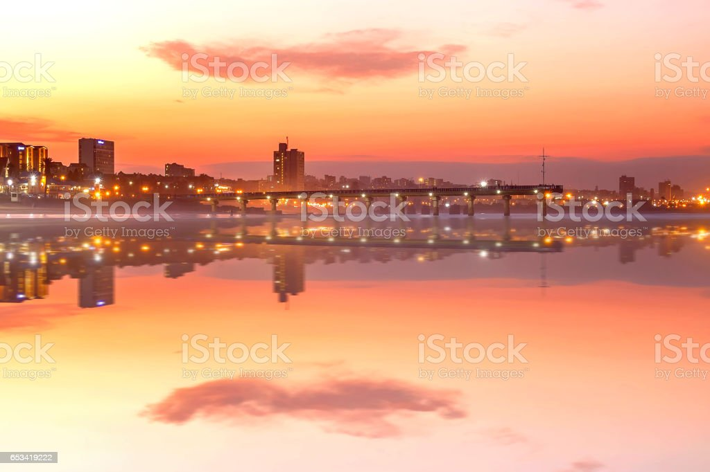 Shark Rock Pier reflections during sunset at Port Elizabeth beachfront. stock photo