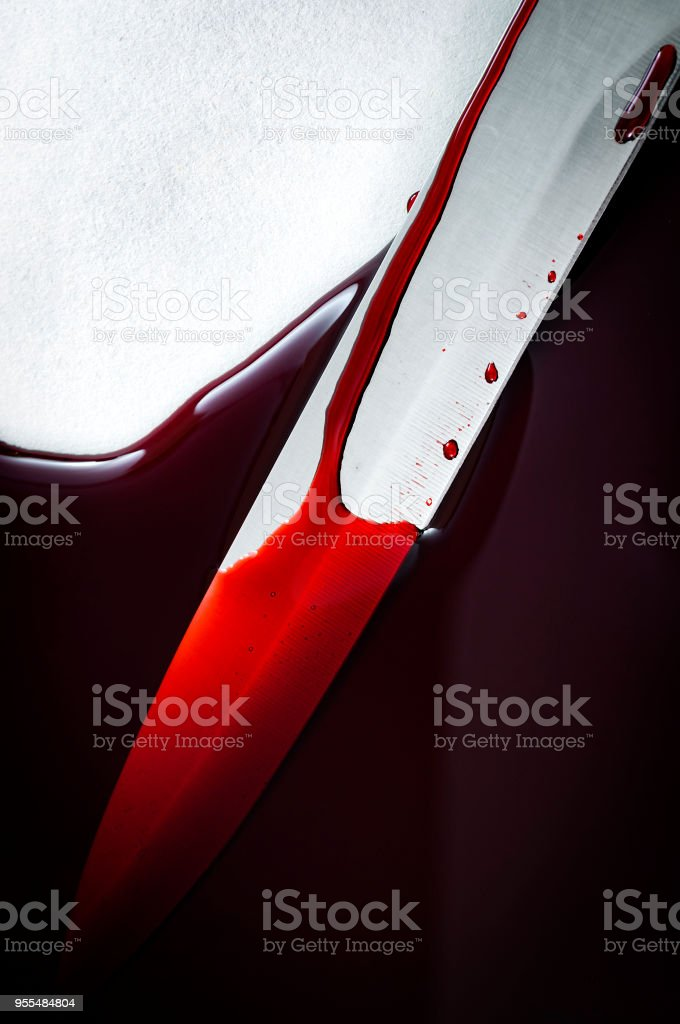 sharp big knife at murder scene in pool of blood stock photo