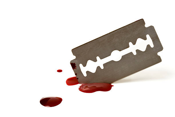 A sharp blade with spattered blood on white background stock photo