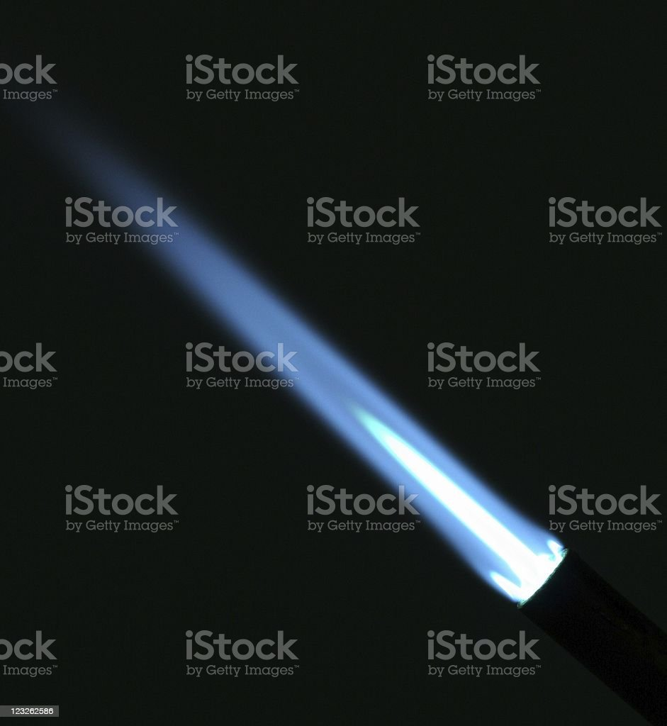 A sharp blue flame from a Bunsen burner stock photo