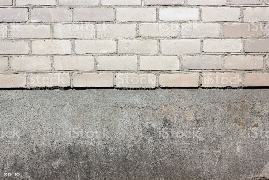 Sharp border between a white silicate bricks and plaster wall texture background stock photo