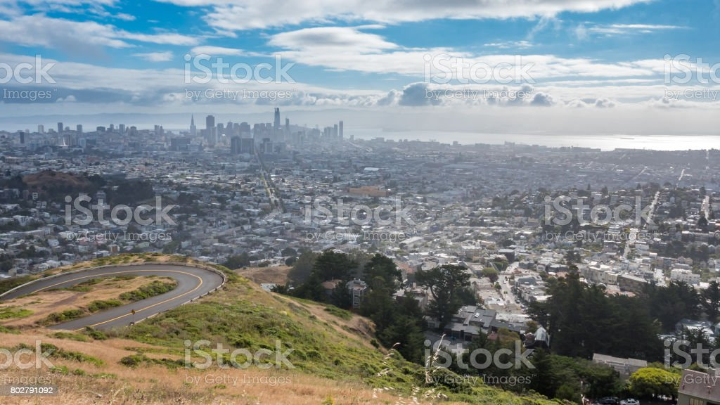 Sharp Curve with a Foggy San Francisco in the background stock photo