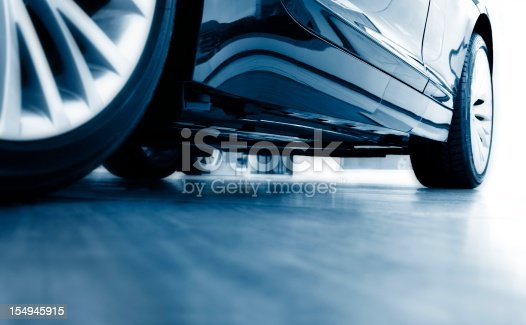 istock Sharp focus ground view of modern blue car 154945915