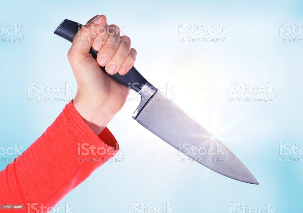 Sharp kitchen knife in a hand stock photo