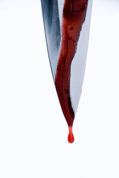 Sharp Murder Knife Weapon with Blood Dripping Droplets stock photo