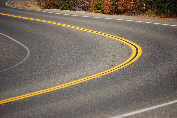 A sharp right angle turn in a road stock photo