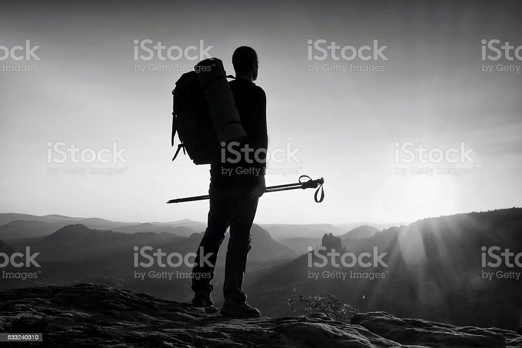 Sharp silhouette  in frame. Tourist guide in mountains stock photo