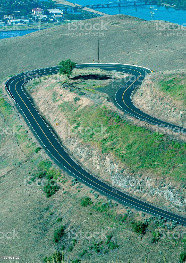 Sharp turn in old road from plateau to river stock photo