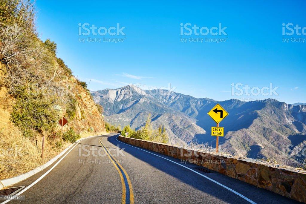 Sharp turn left sign in Yosemite National Park, USA. stock photo