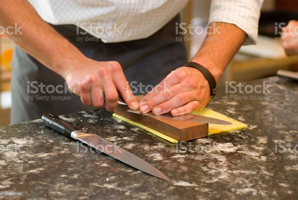 sharpen the knife - Messerschärfen mit Schleifstein stock photo