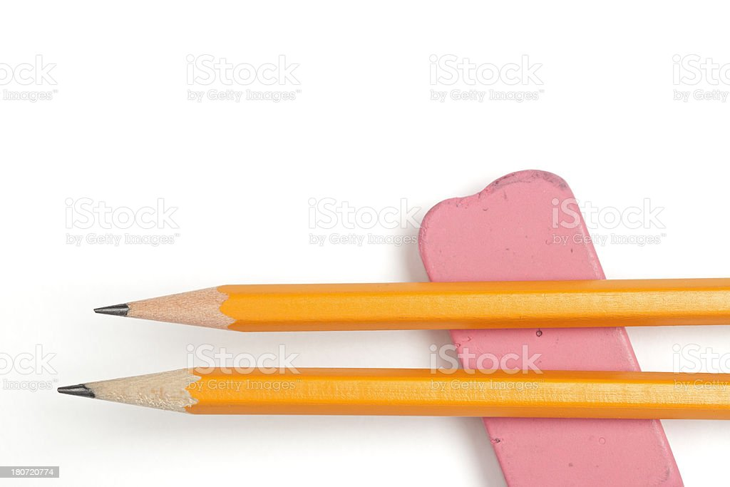Close-up of pencils resting on a pink eraser. Studio isolated on a...