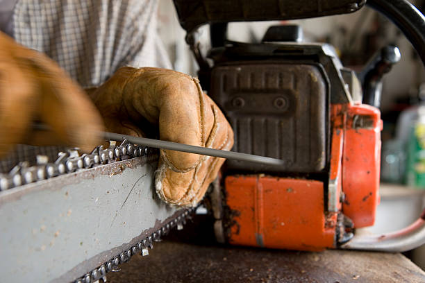 sharpening a chainsaw - chainsaw stock photos and pictures