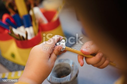 A close up shot of a boy sharpening a pencil in the classroom. This is a school in Hexham, Northumberland in north eastern England.
