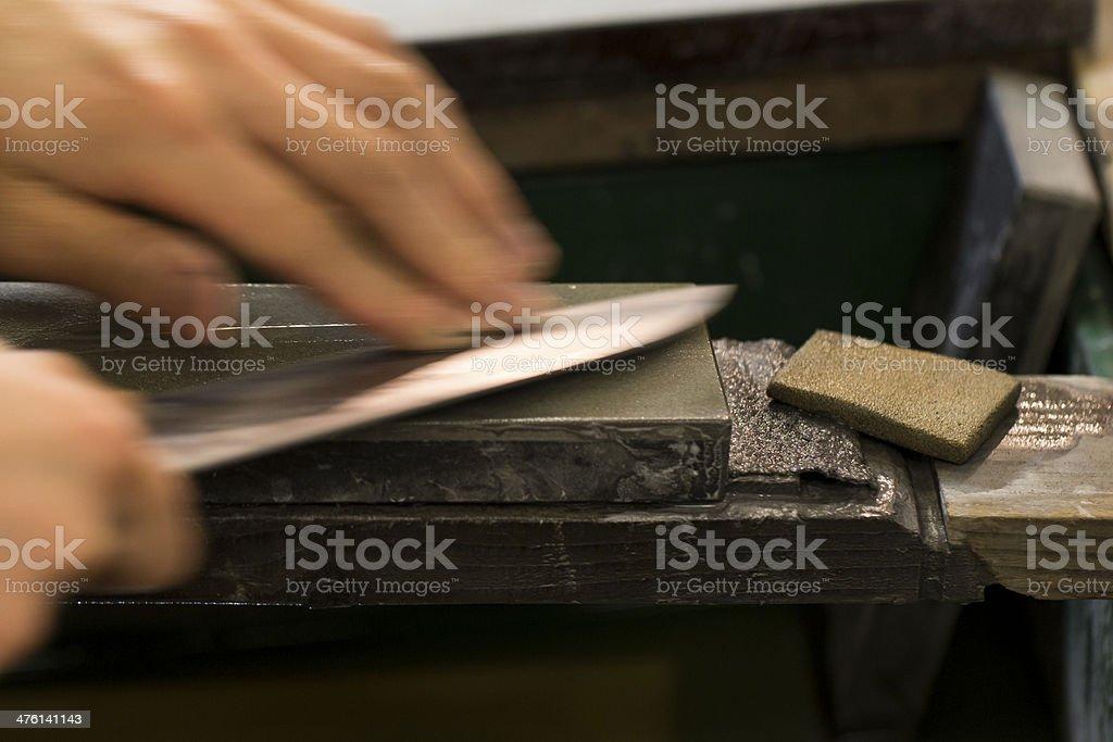 Sharpening Knife on Whetstone stock photo