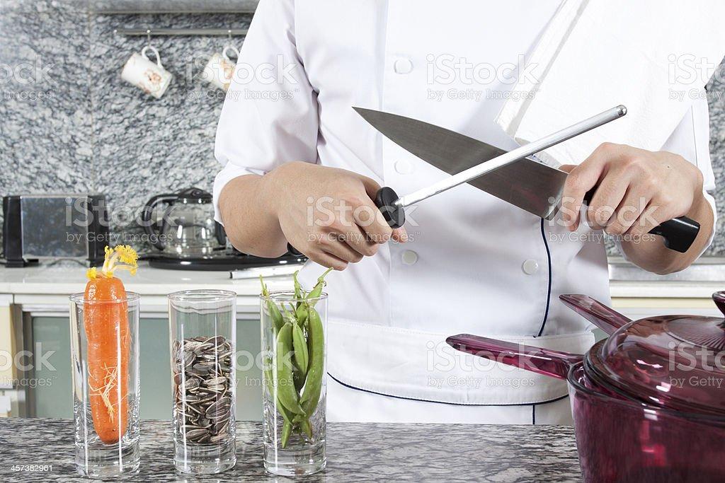 Sharpening knife stock photo