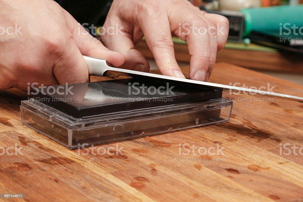 Sharpening knife. stock photo