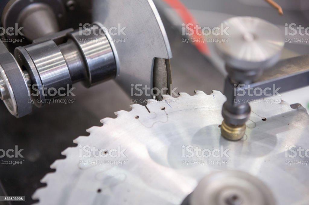 Sharpening of circular saw blade stock photo