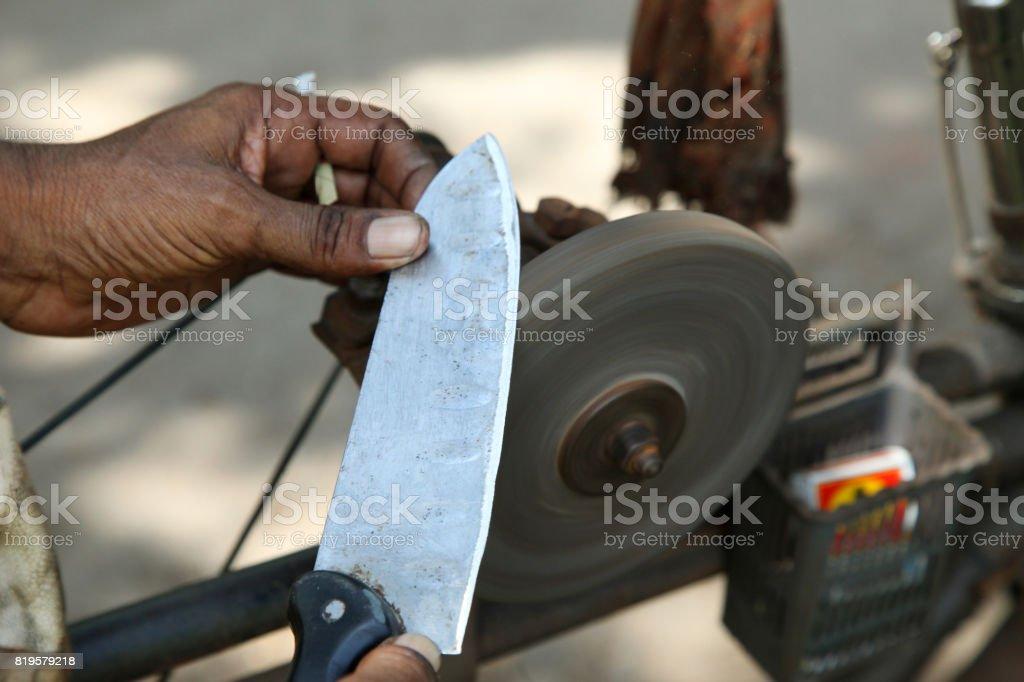 sharpening the knife with whetstone stock photo