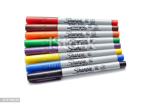 Vancouver, B.C., Canada -- March 7, 2015:Close up of a variety of colours of Sharpie brand markers on a white background with shadows.