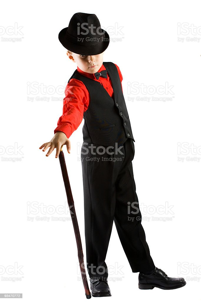Sharply dressed boy dancer with hat and cane on white stock photo