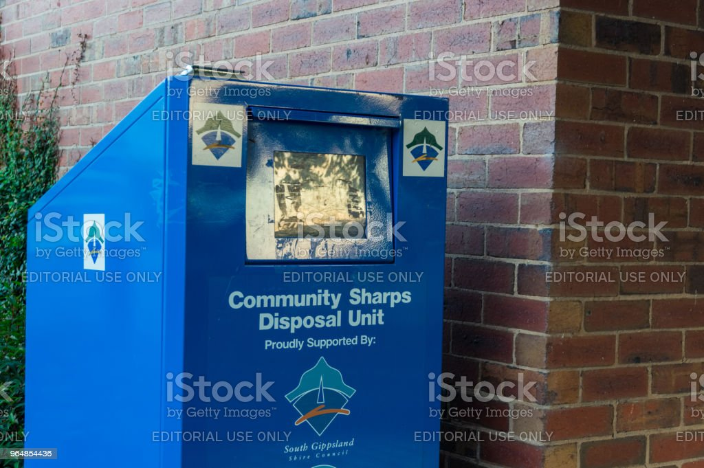 Sharps disposal unit for disposing of syringes and needles. royalty-free stock photo
