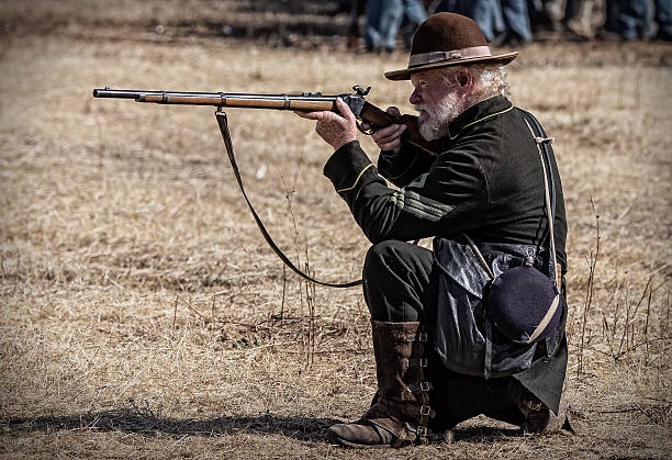 Sharpshooter Anderson, California, United States-September 27, 2014: Union sharpshooter taking aim at a target in the Confederate lines during a Civil War reenactment. american civil war stock pictures, royalty-free photos & images