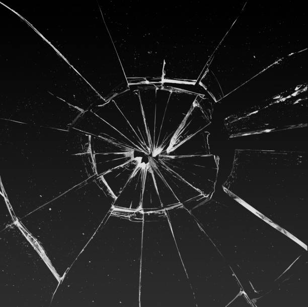 Shattered and broken glass on a dark background stock photo