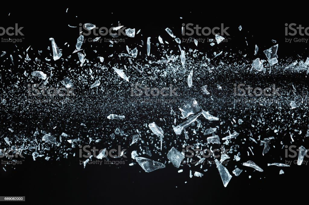 Shattered crystals flying stock photo