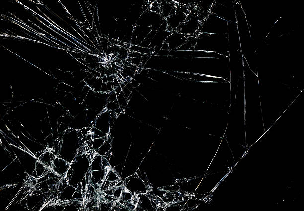 shattered glass in dark background - splittrat glas bildbanksfoton och bilder