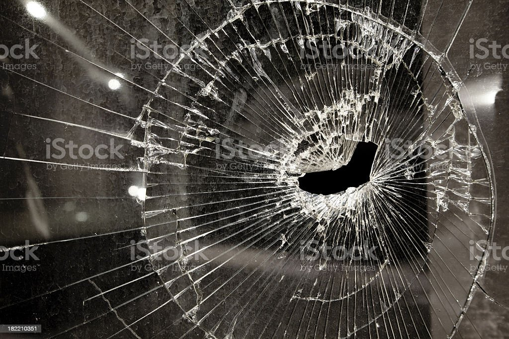 Shattered Glass Window of Abandoned Business in Bad Economy stock photo