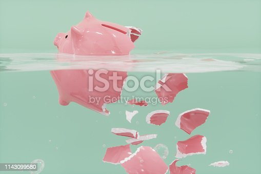 istock Shattered Piggy Bank In The Water 1143099580