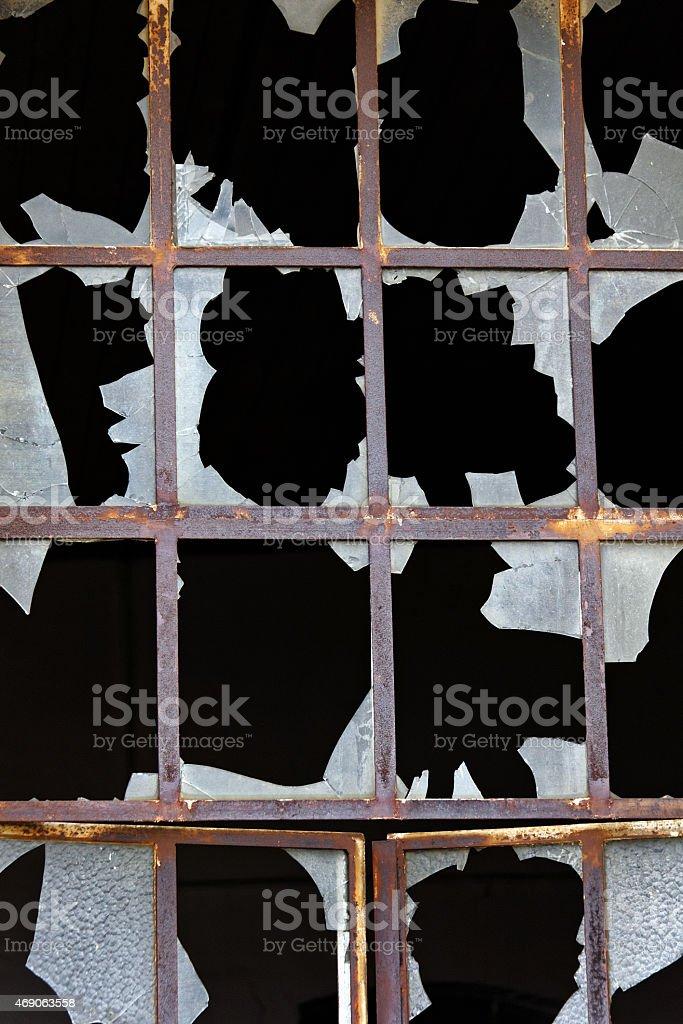 shattered window glass stock photo