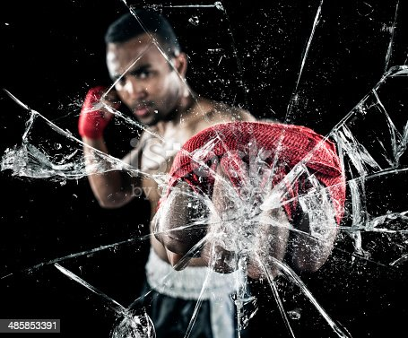 160558362 istock photo Shattering glass with punch 485853391