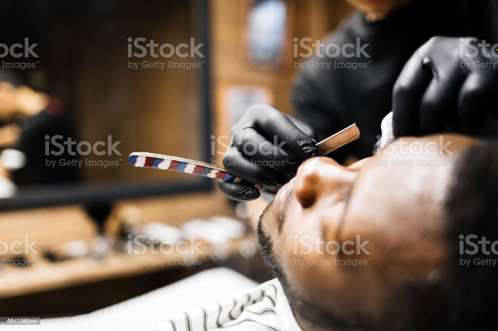 Shave with razor blade stock photo