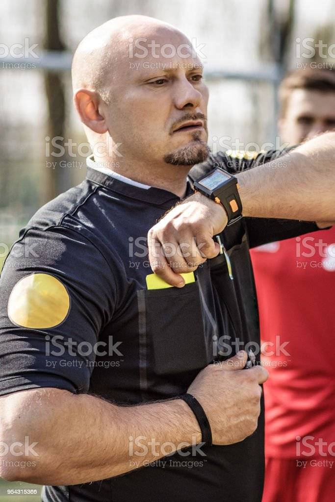 10b460a30 Adult, Adults Only, Athlete, Coach, Men. Shaved handsome caucasian male  soccer referee during a football match royalty-free ...