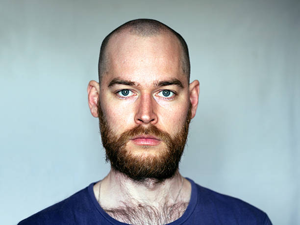 Shaved Head Man With Beard stock photo