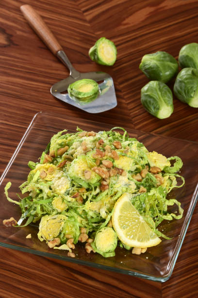 Shaved Raw Brussels Sprout Salad with Walnuts stock photo