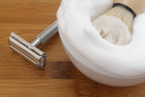 Shaving accessories on wooden background. Shaving accessories on wooden background. Razor, brush and foam in bowl. shaving brush shaving cream razor old fashioned stock pictures, royalty-free photos & images