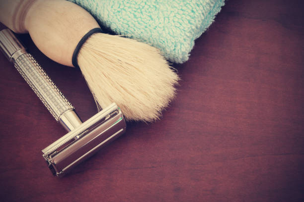 Shaving accessories on wooden background. Shaving accessories on wooden background. Razor, brush and towel. shaving brush shaving cream razor old fashioned stock pictures, royalty-free photos & images
