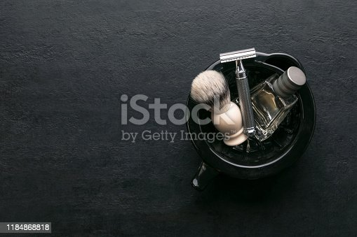 1126324804 istock photo Shaving accessories set on a dark background, top down view 1184868818